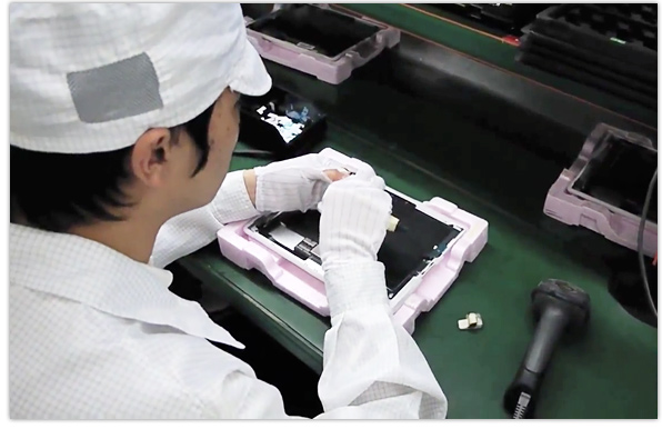 Foxconn workers assemble an iPad